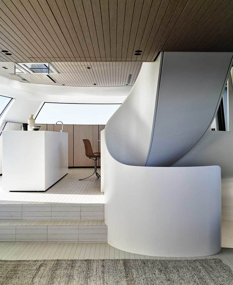 Curved staircases and other architectural features are showing up on midsize yachts.