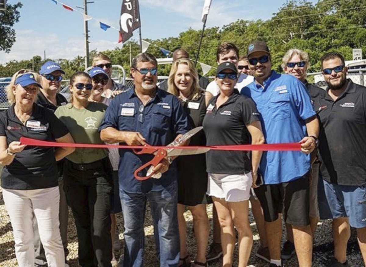 The crew at Eric's Outboard Key Largo cuts the ribbon to open up shop.