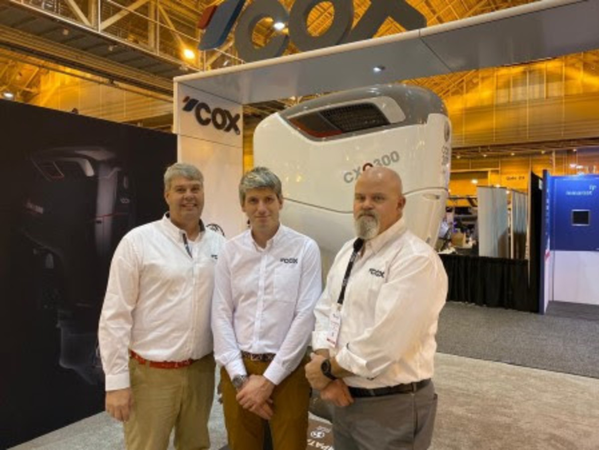 From left: Woodfin, Pitt and Livingston on the Cox booth at the International Workboat Show.