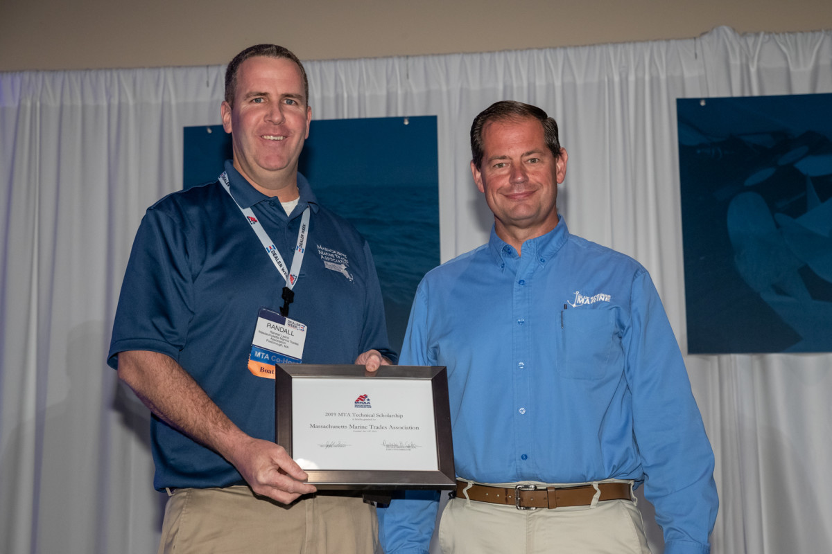 Randall Lyons (left) accepted the scholarship Dec. 10 during Dealer Week.