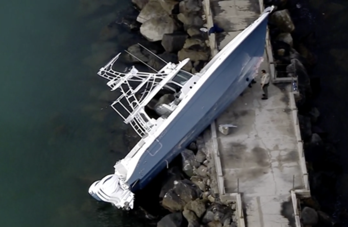 The boat came to rest on the rocks of a Dania Beach jetty.