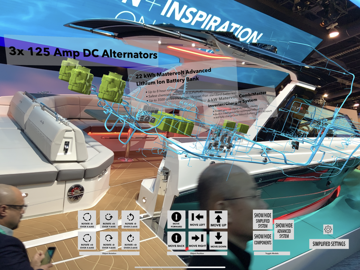 The Augmented Reality above the Sea Ray SLX-R 400-e at the CES booth shows the boat's inner functions.