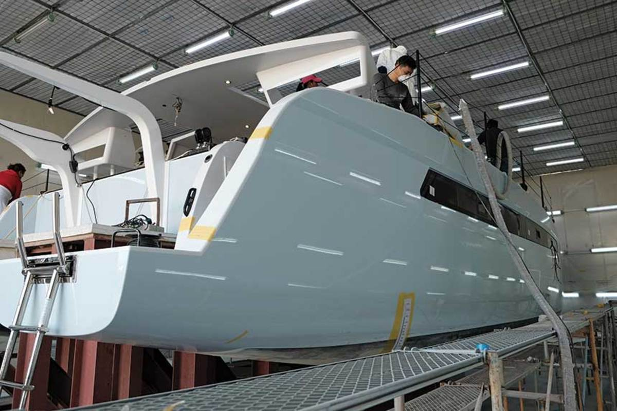 HH Catamarans' staff perform much of the work by hand, while China's low labor costs give it a significant market advantage.