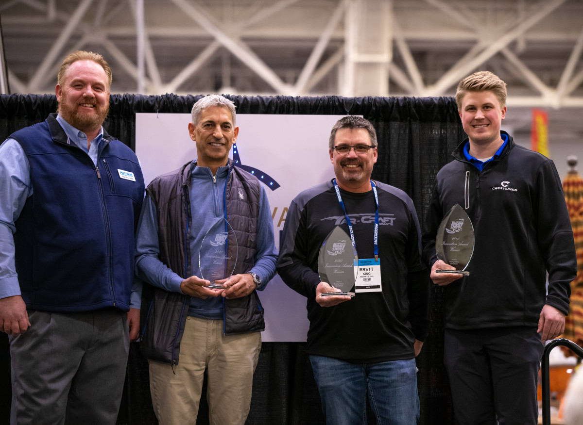 (From left) Innovation Awards judge chair Brady Kay with winners from Avalon and Tahoe, Yar-Craft and Crestliner.