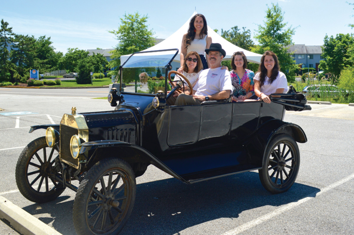 Don Gross with his wife and daughters in the Model T he drove for the company's centennial celebration.
