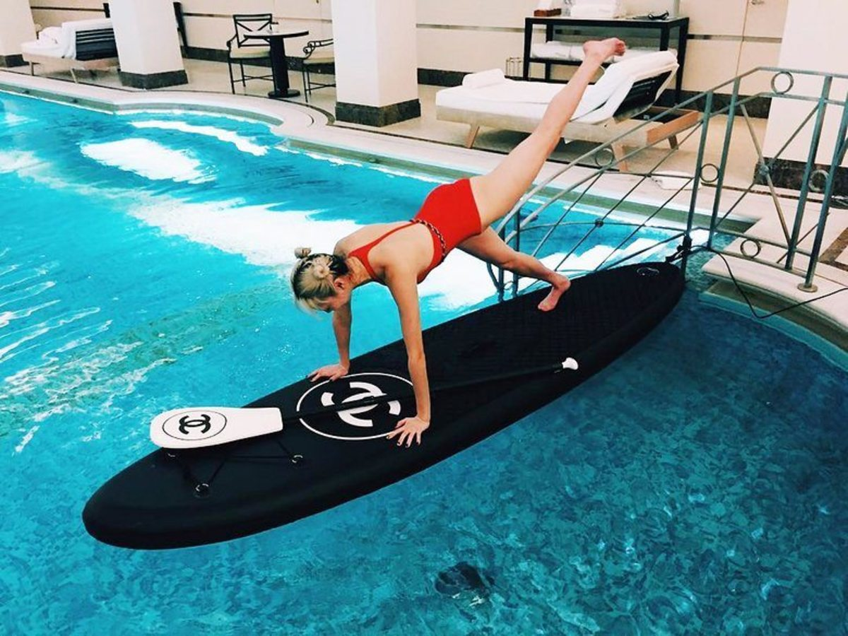 Armani and Chanel (above) have jumped into the high end of the paddleboard business.