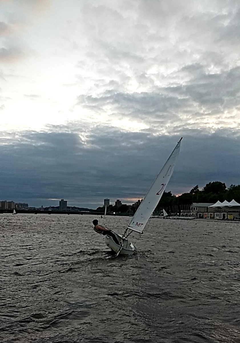 Dowell sailing solo thanks to her audio telltales in a dinghy competition at MIT.