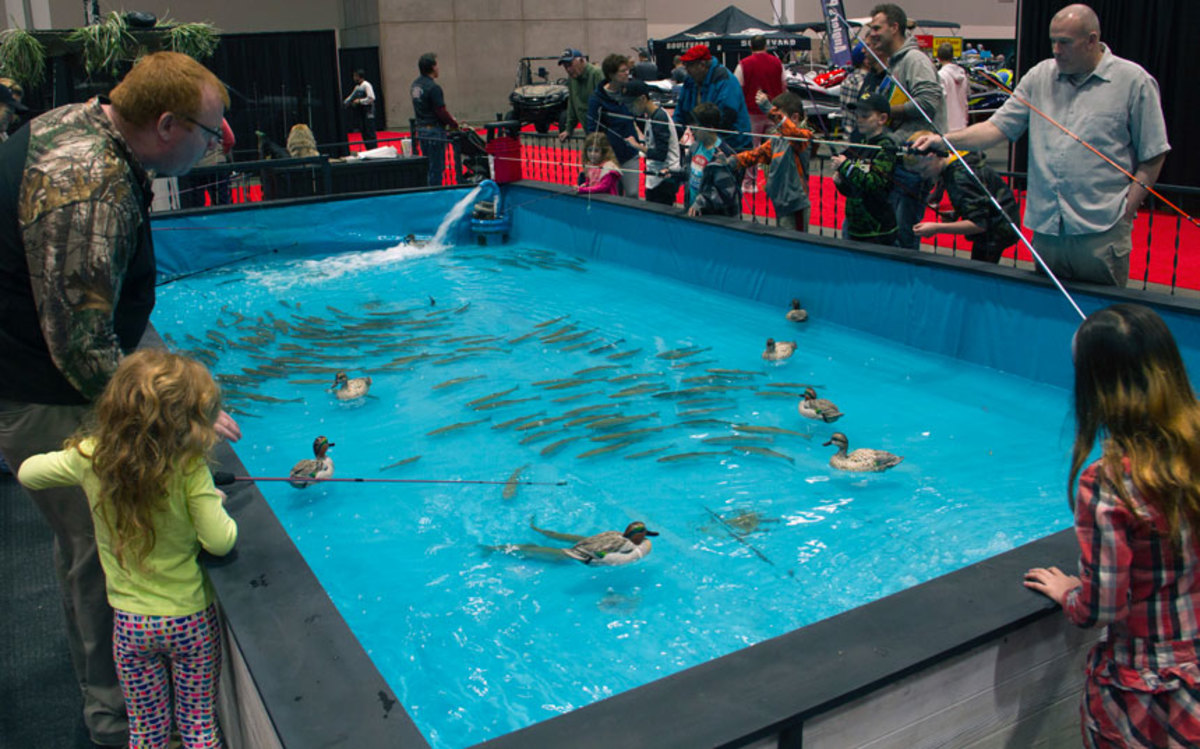 The trout pond at the Kansas City Boat & Sportshow is a draw for families.