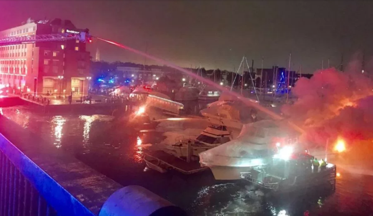 Firefighters work to keep fire from spreading to other boats last night at Constitution Marina in Boston. Photo courtesy of Boston Fire Dept/Twitter.