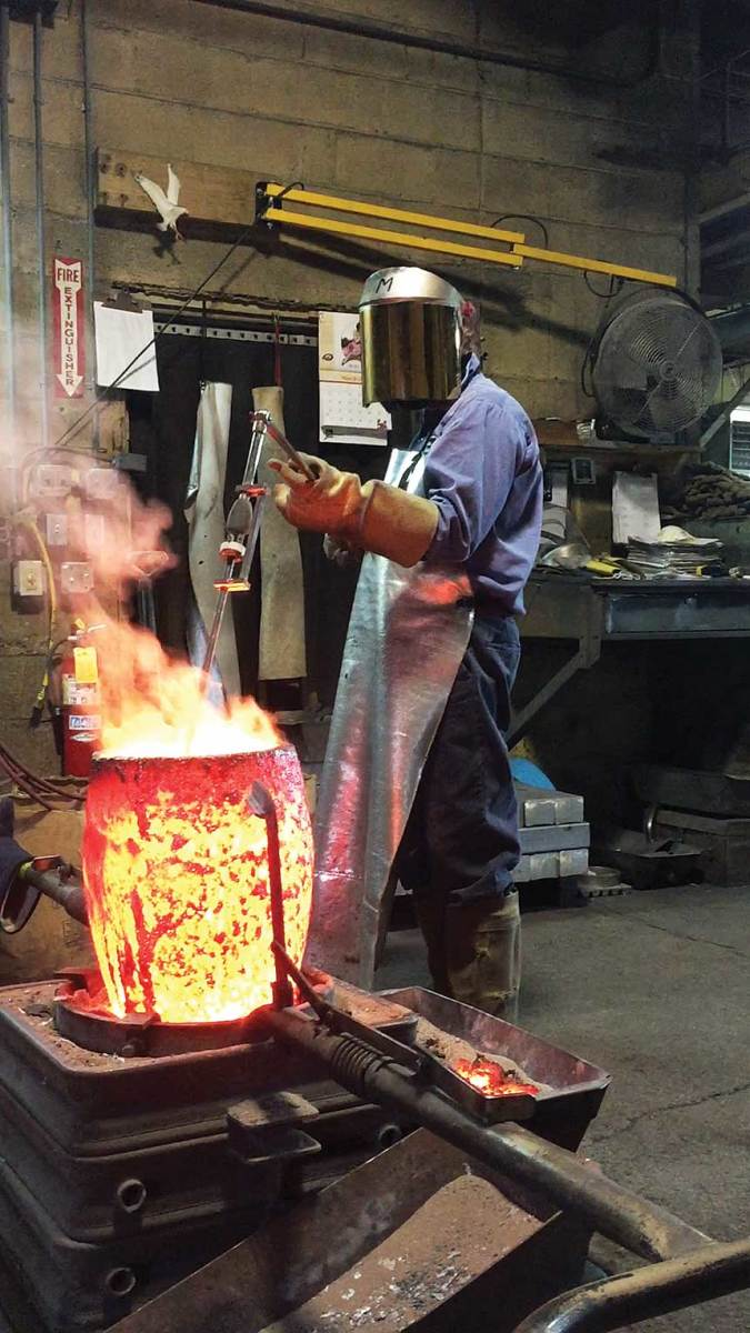 A worker checks the temperature of molten metal at the Edson Anbar foundry.