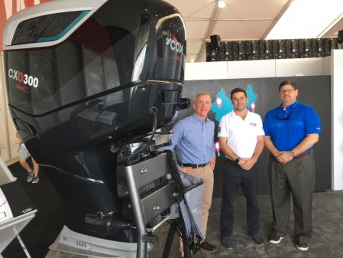 Ring Power's Rick Chapman (left) and Keith Moore (right) with Cox Powertrain global sales director Joel Reid.