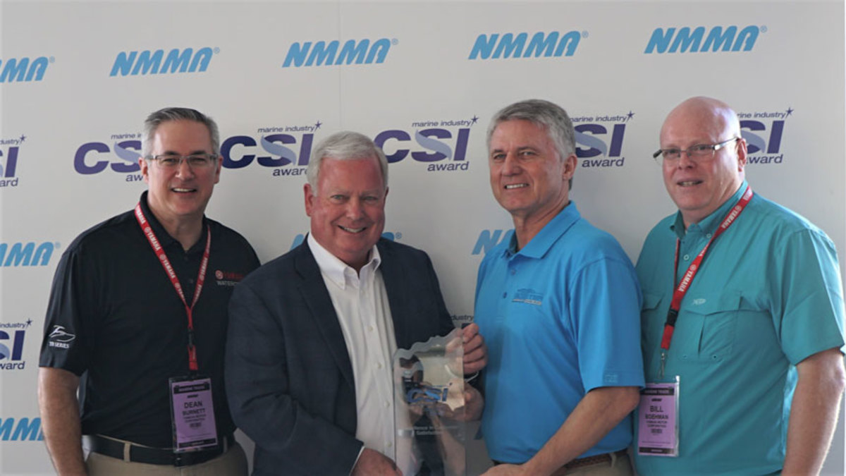 (From left) Yamaha boat business chief sales and marketing officer Dean Burnett, NMMA president Thom Dammrich, Skeeter Boats vice president Jeff Stone Sr. and Bill Boehman, Yamaha chief marine operations and manufacturing officer/vice president of Yamaha Motor Corp.
