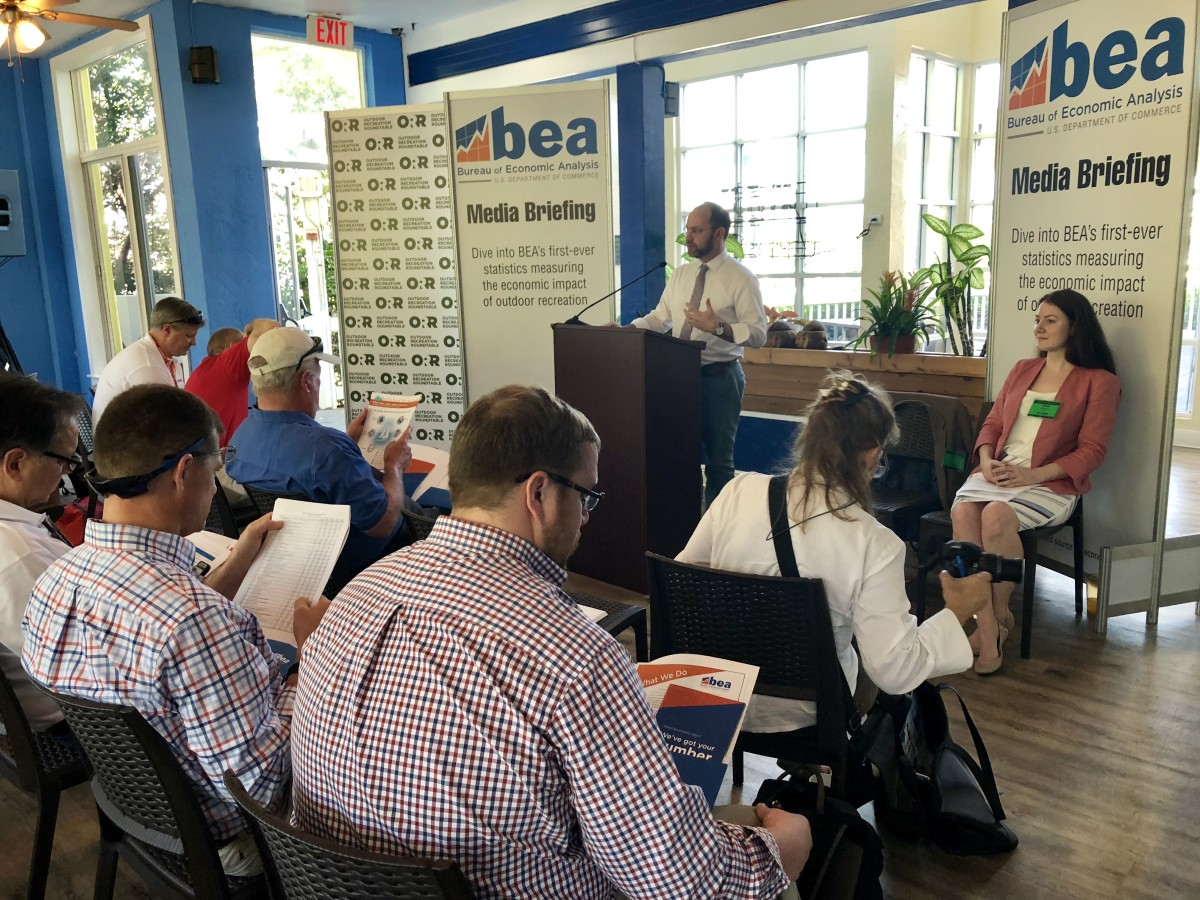 BEA communications chief Lucas Hitt (at podium) and economist Tina Highfill unveiled preliminary data at the Miami International Boat Show that shows outdoor recreation's 2.2 percent contribution to the U.S. GDP.