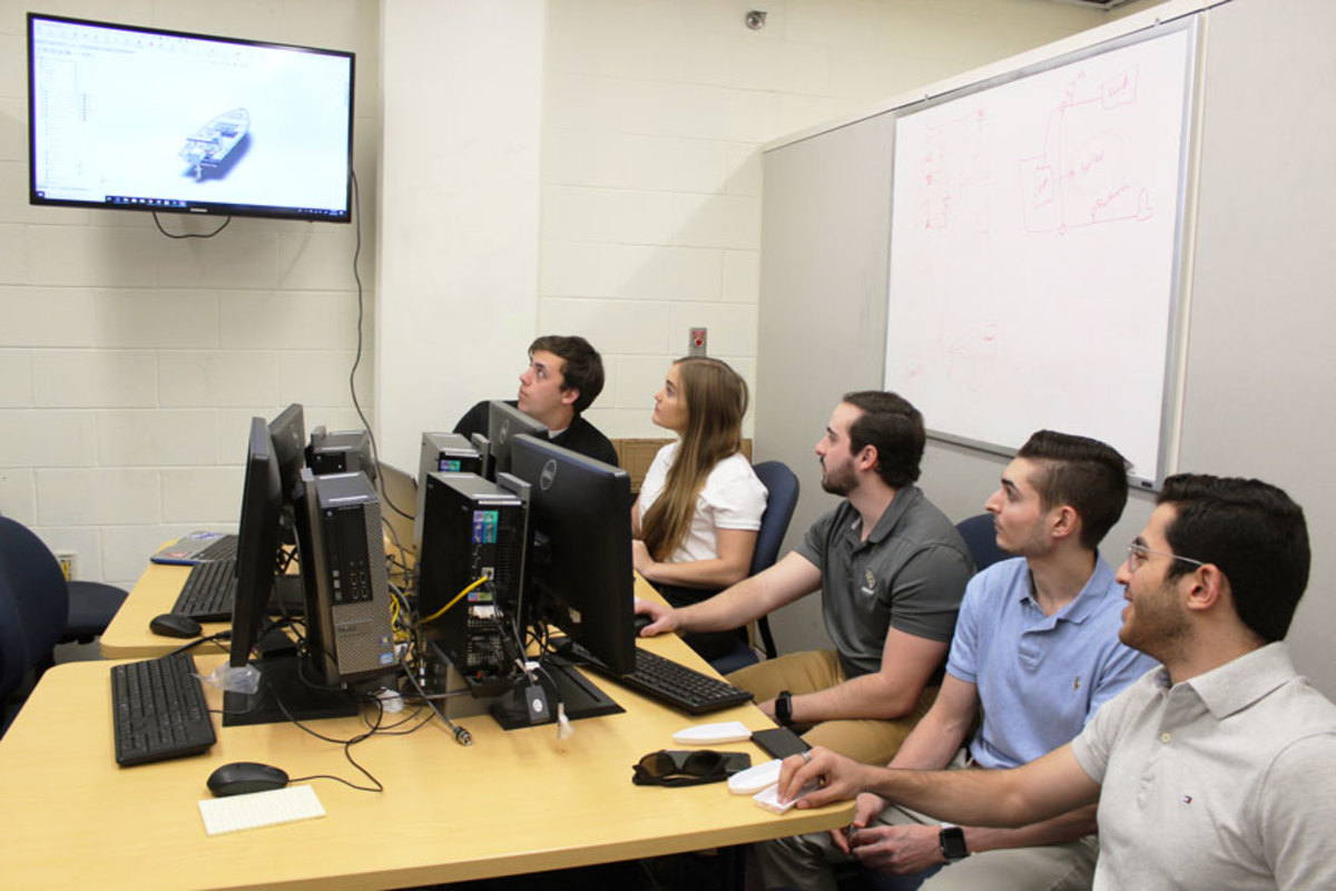 (From left) UCF mechanical engineering students Troy Williams, Taylor Bell, Michael Cordero, Michael Testa and Talat Al Khaldi.