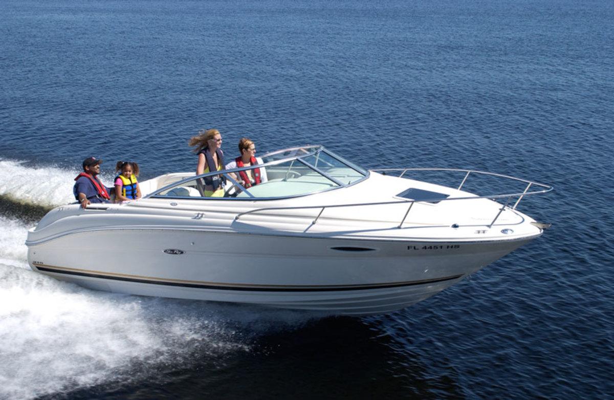 family-in-boat-underway