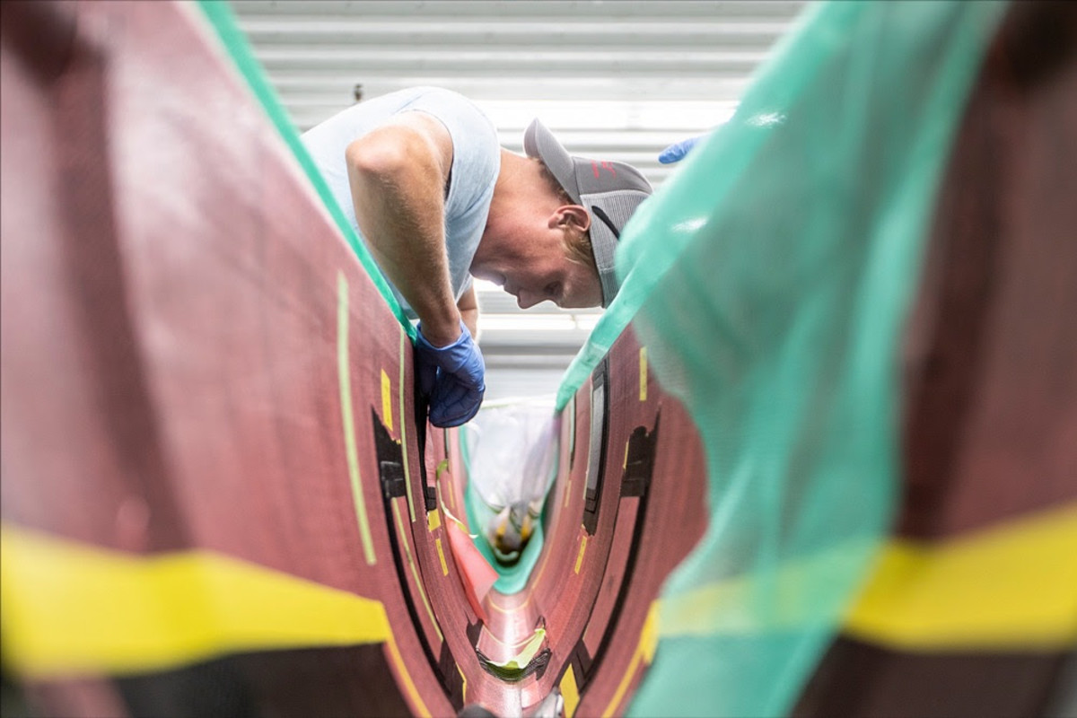 IYRS graduate and American Magic boatbuilder James Allsopp (Annapolis, Md.) works at the team's production facility in Bristol, Rhode Island.