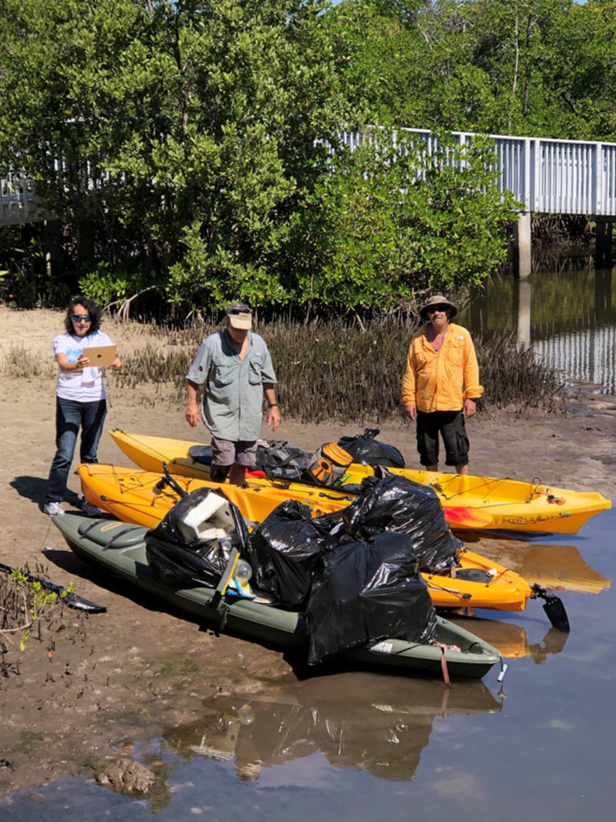 All forms of boats were used to help pick up trash and debris. Photo by Anne Kolb.