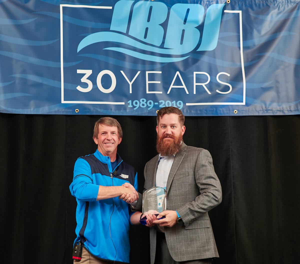 IBBI president Tom Broy (left) presents the award to Michael Range, Garmin's engineering business development manager for marine.