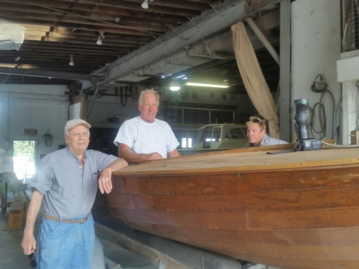 From left, Fred, Jr., Fred A and Kevin Scopinich at work on a classic wooden boat.