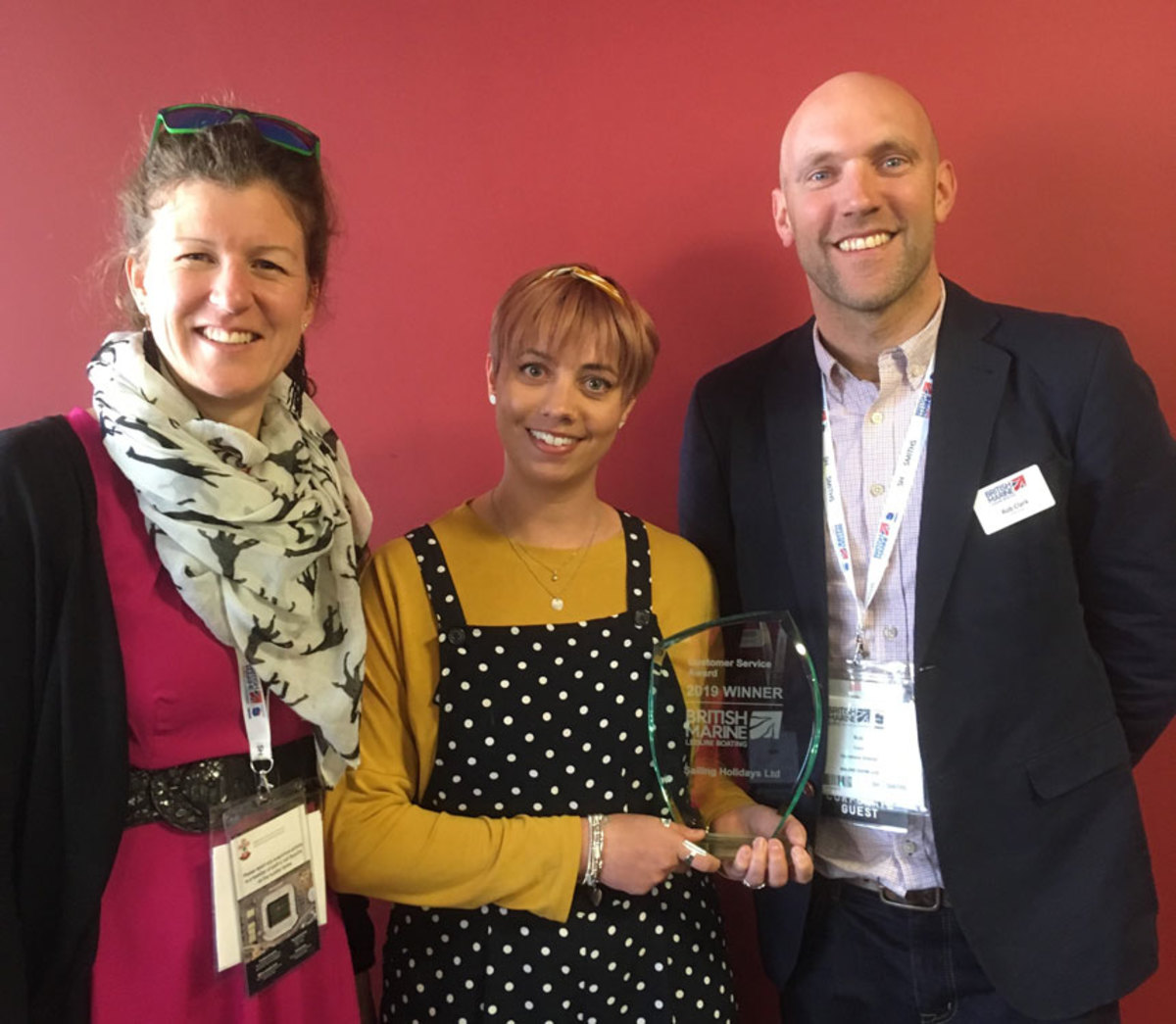 Staff from Sailing Holidays accept the British Marine Leisure Boating Customer Service Award.