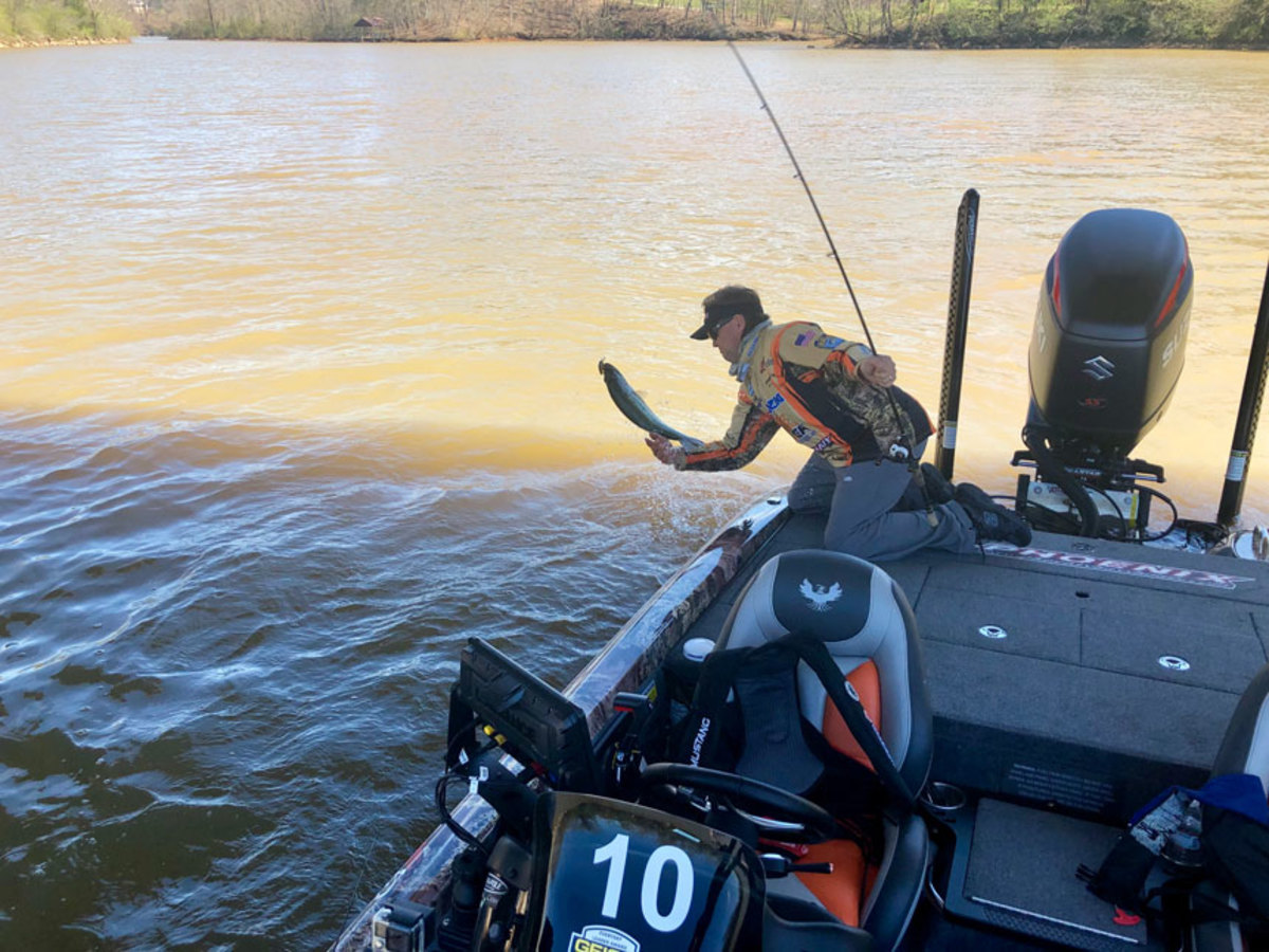 Tournament competitor Clifford Pirch brings in a fish.