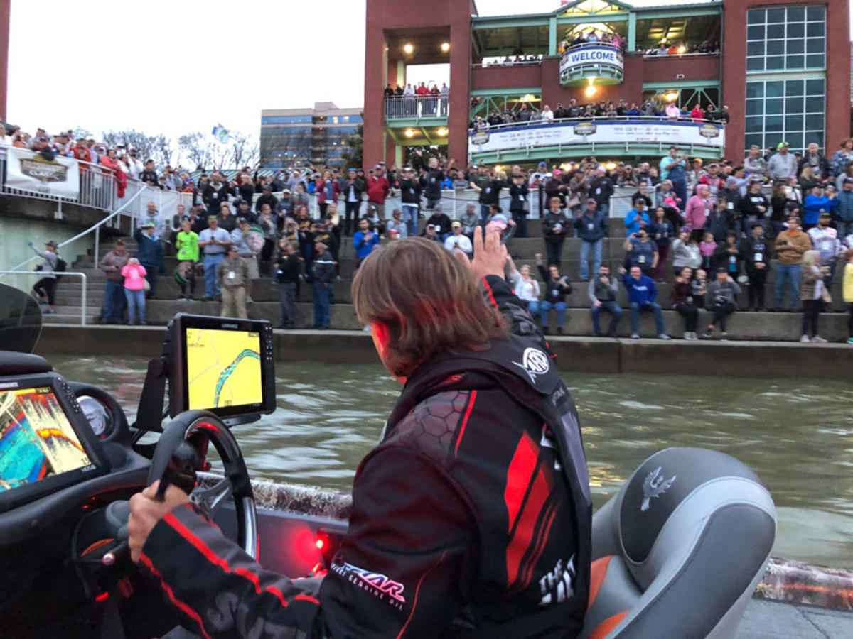 Fans braved the elements to cheer for their favorite anglers at the start of the tournament.