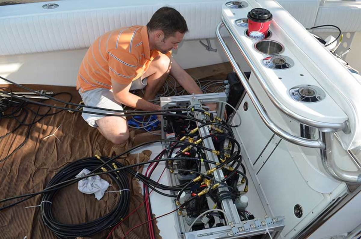 SeaStar Solutions' Richard Redfern installs equipment for ABYC's testing of steering loads with multiple outboards.