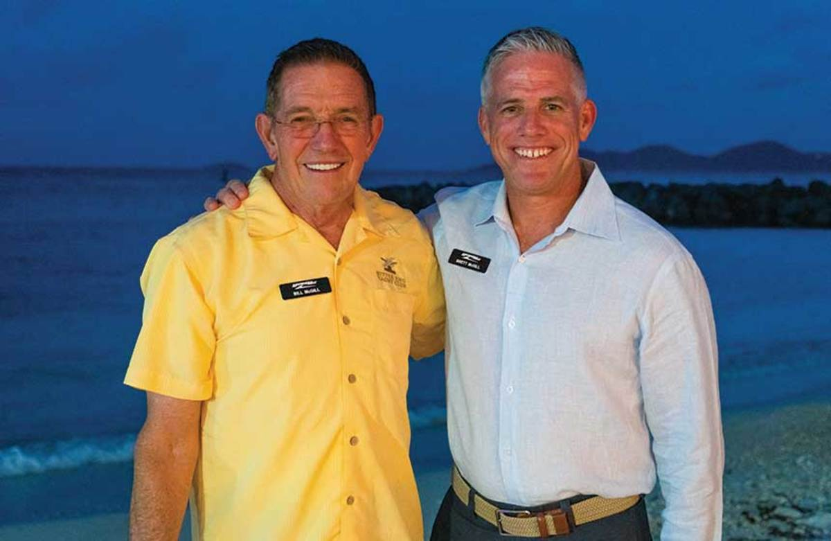 Passing the torch: Bill and Brett McGill still speak daily about MarineMax strategy.
