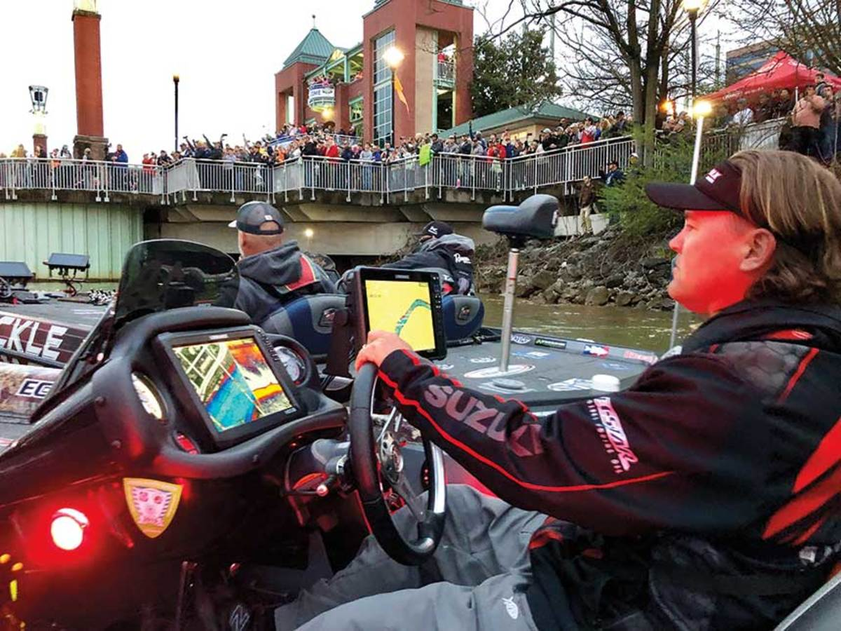 Hail to the heroes: 5,500 fans cheered on pro fishermen like Clifford Pirch at dawn at the starting line in Knoxville of the Bassmaster Classic.
