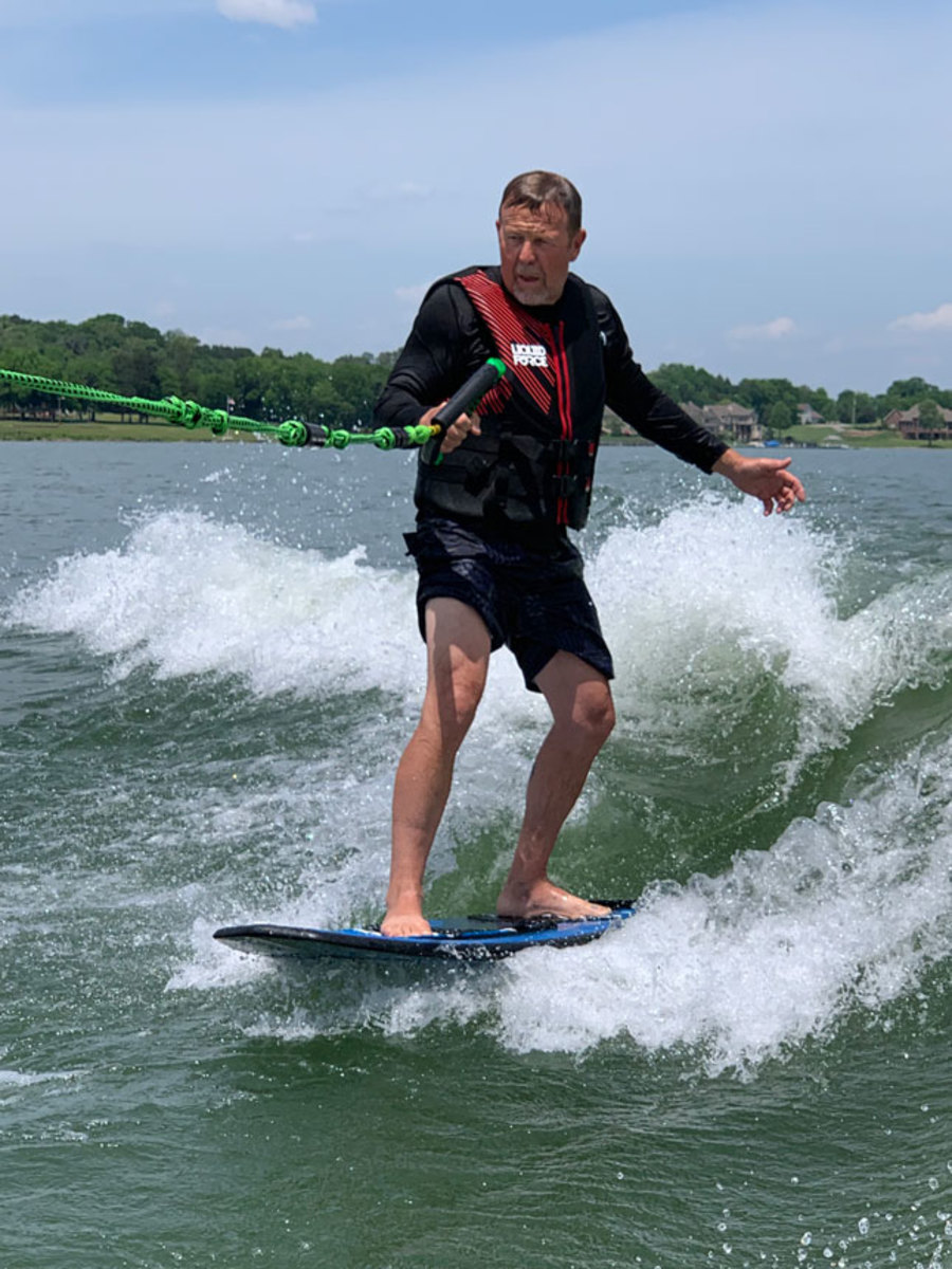 Jim Archambault had a successful ride his first time on a wakesuring board.