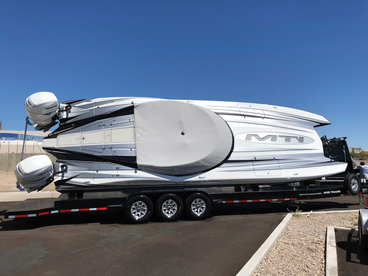 MYCO builds tilt trailers for boats that are too wide for road transport.