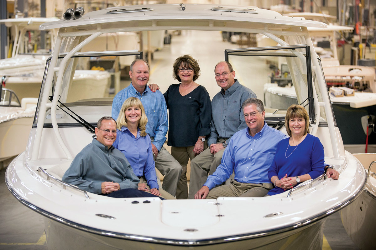 Grady-White's management team (from left): Doug Gomes, marketing and sales senior advisor; Shelley Tubaugh, vice president of marketing; Joey Weller, vice president of sales; Kris Carroll, president; Mark Doggett, executive vice president and vice president of manufacturing; David Neese, vice president of engineering (retired); and Jill Carraway, vice president of finance.