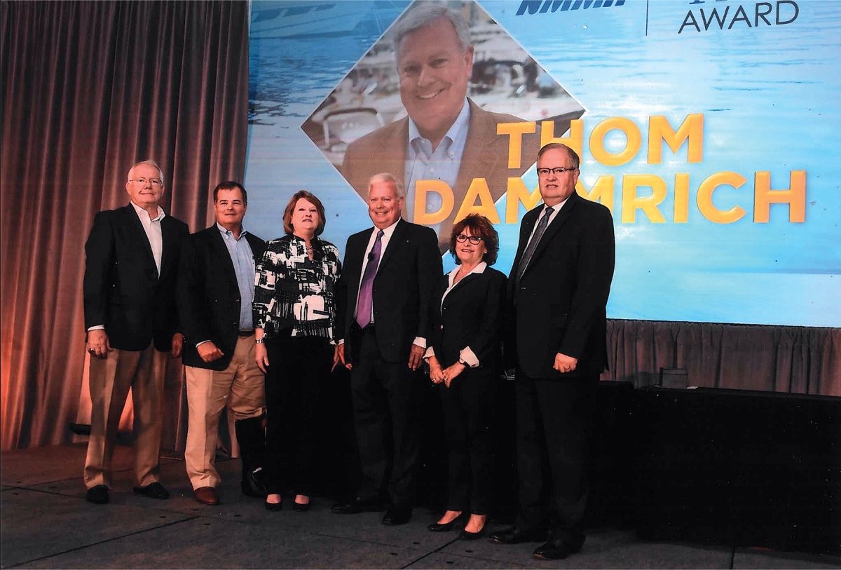 Both women cite the leadership of past NMMA president Thom Dammrich (center) as vital to the industry.