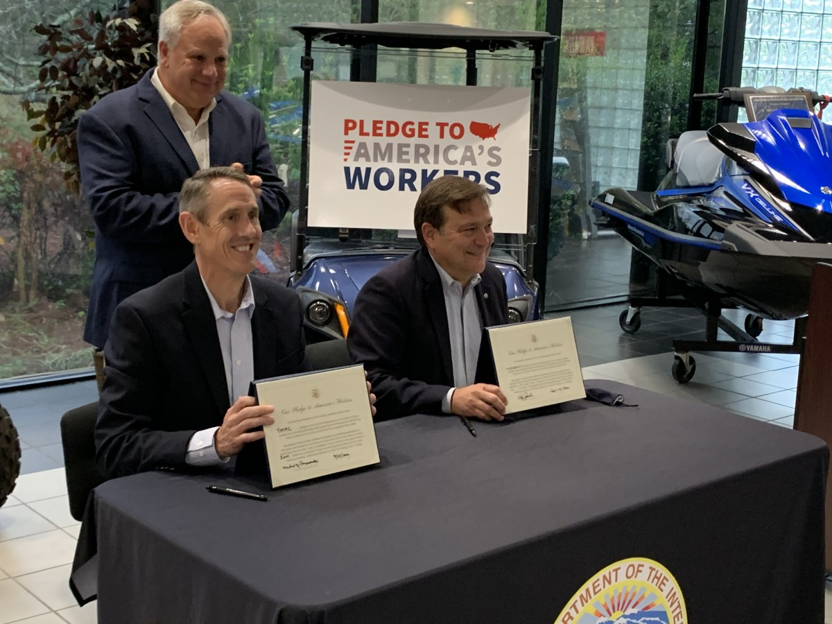 U.S. Secretary of the Interior David Bernhardt (standing) with Mike Chrzanowski, president of Yamaha Motor Manufacturing Corp. (left), and Ben Speciale, president of Yamaha U.S. Marine Business Unit. Photo: Business Wire