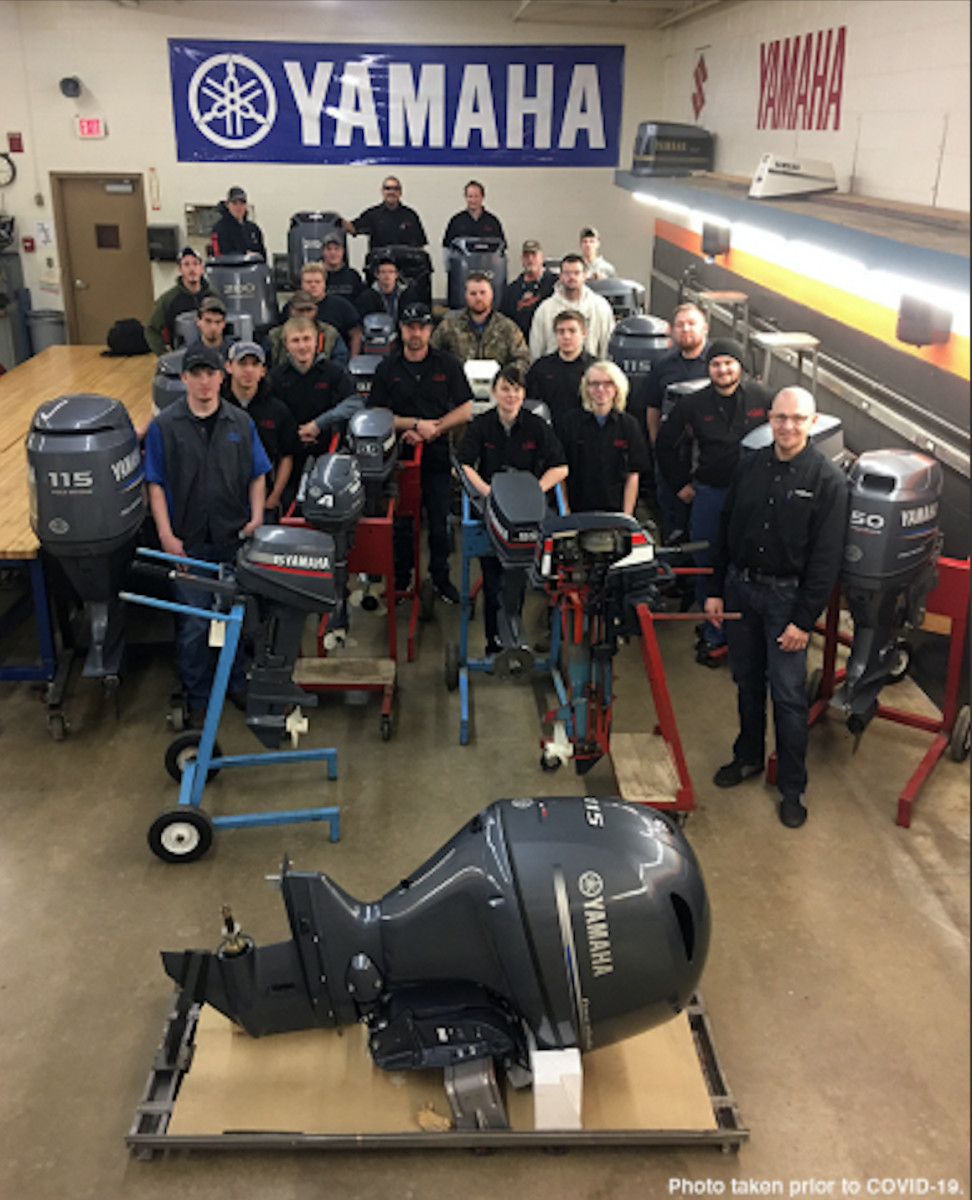Students from the first Yamaha Technical School Partner, Minnesota State Community and Technical College, stand among the Yamaha outboards used during class for marine technician training. Yamaha's Technical School Partner program reached 100 members this month.