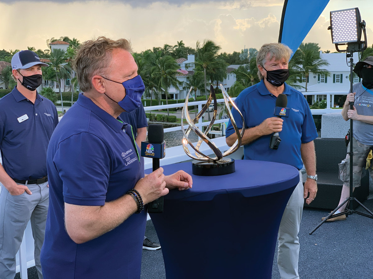Viking CEO Pat Healey, flanked by sons Justin and Sean, accept the Best in Show award from NBC Sports