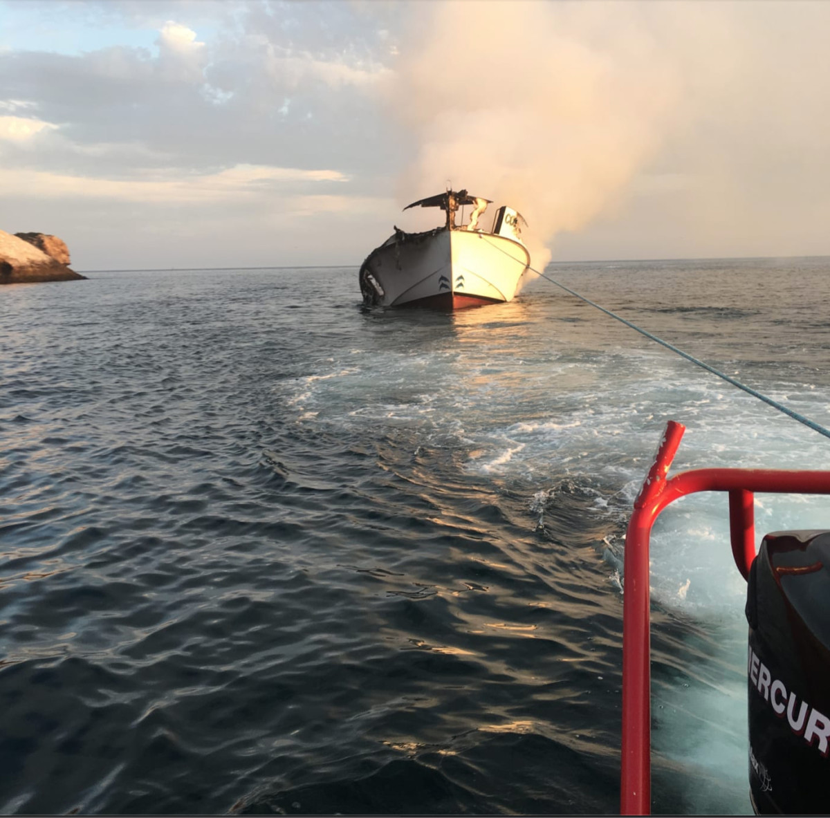 Responders initially planned to tow the boat elsewhere so workers could start the recovery phase, but the vessel quickly sunk before being recovered. Photo courtesy of Paul Amaral, an emergency responder.