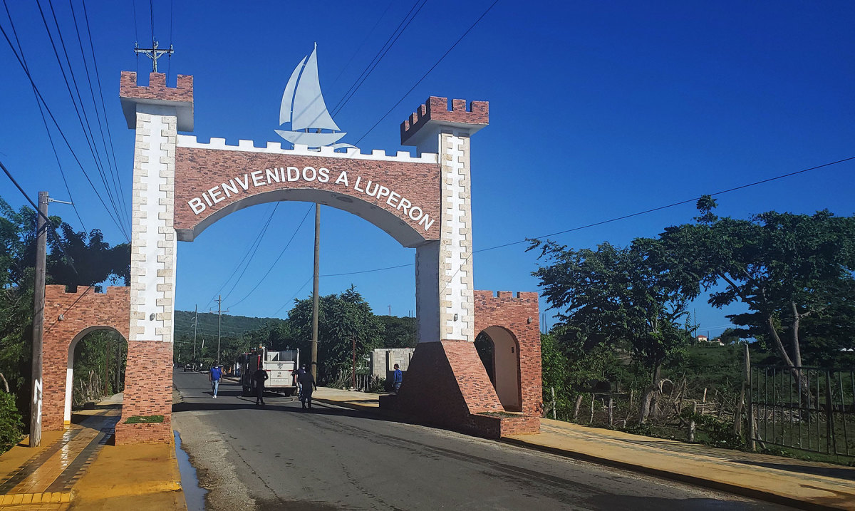 A new gate to the village is topped with a stylized sailboat, a visual symbol of the rebranding effort.
