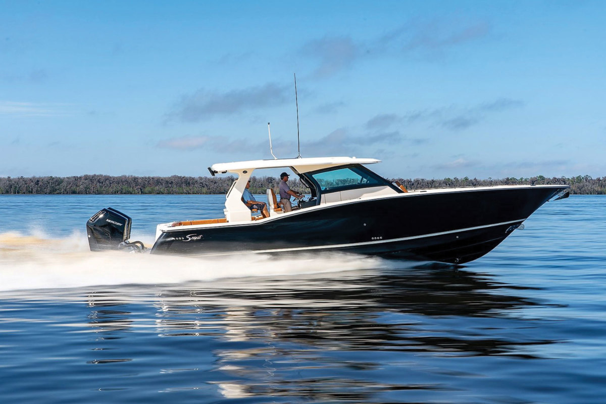 Scout is one of several builders that will offer the outboards as standard or optional equipment. (Left) The steerable gearcase  pivots 45 degrees in either direction.