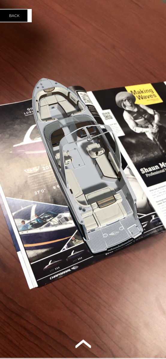 Using an iPhone app, scanning this Chaparral augmented reality print advertisement makes a boat pop up that customers can customize.