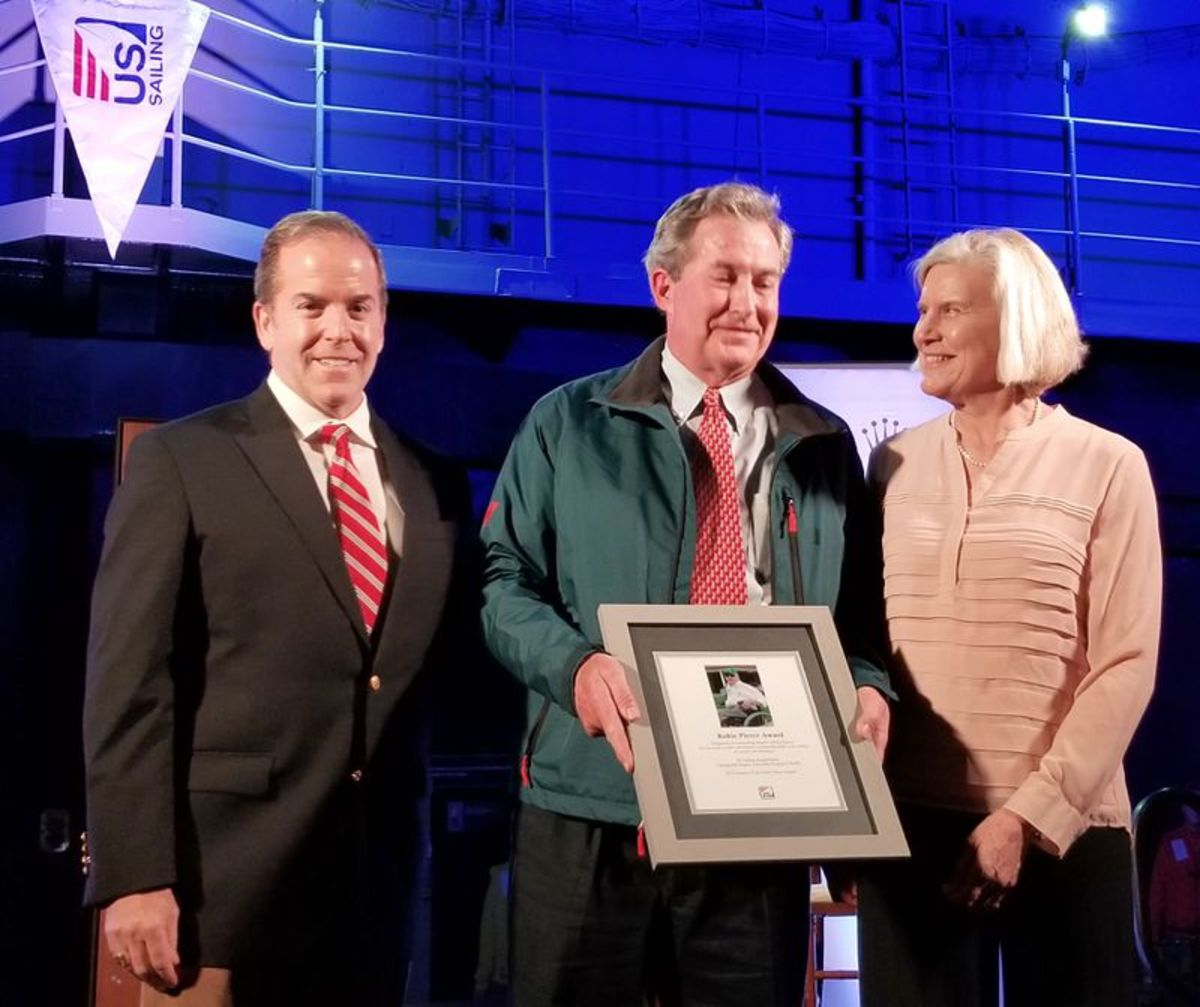 """(From left) Robbie Pierce, who is the son of Robie Pierce, Paul """"Bo"""" Bollinger, and US Sailing president Cory Sertl on the flight deck of the USS Midway in San Diego. Photo by Elizabeth Bollinger"""