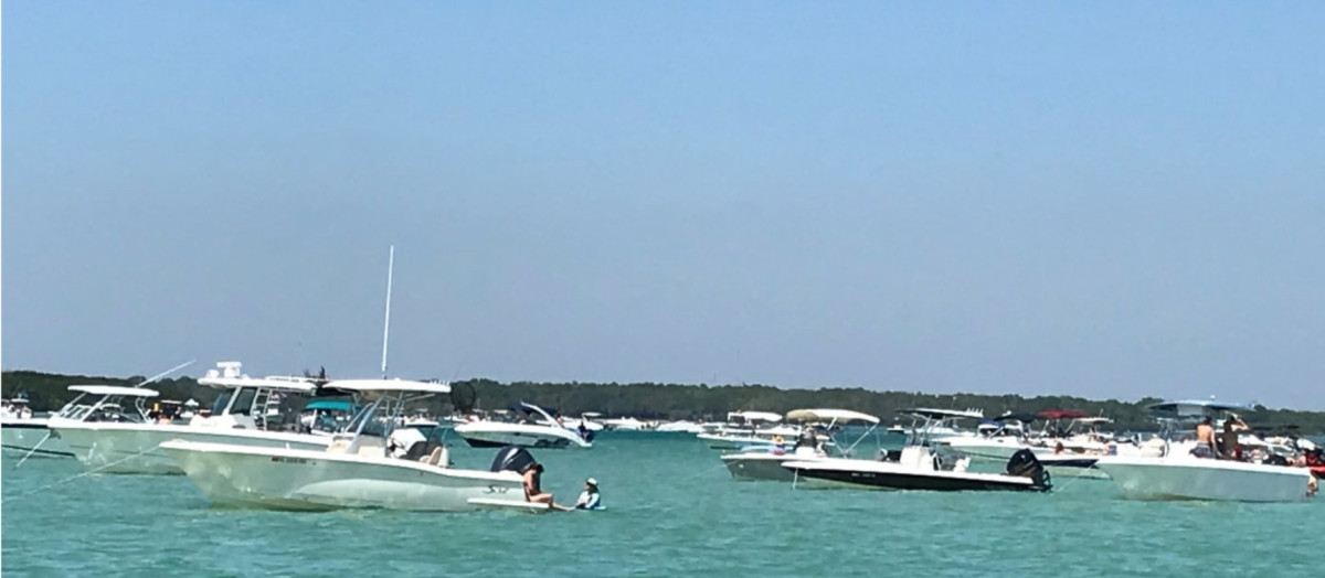 Boaters practice social distancing while anchored, with no rafting up, in Madeira Beach inlet on Florida's west coast.