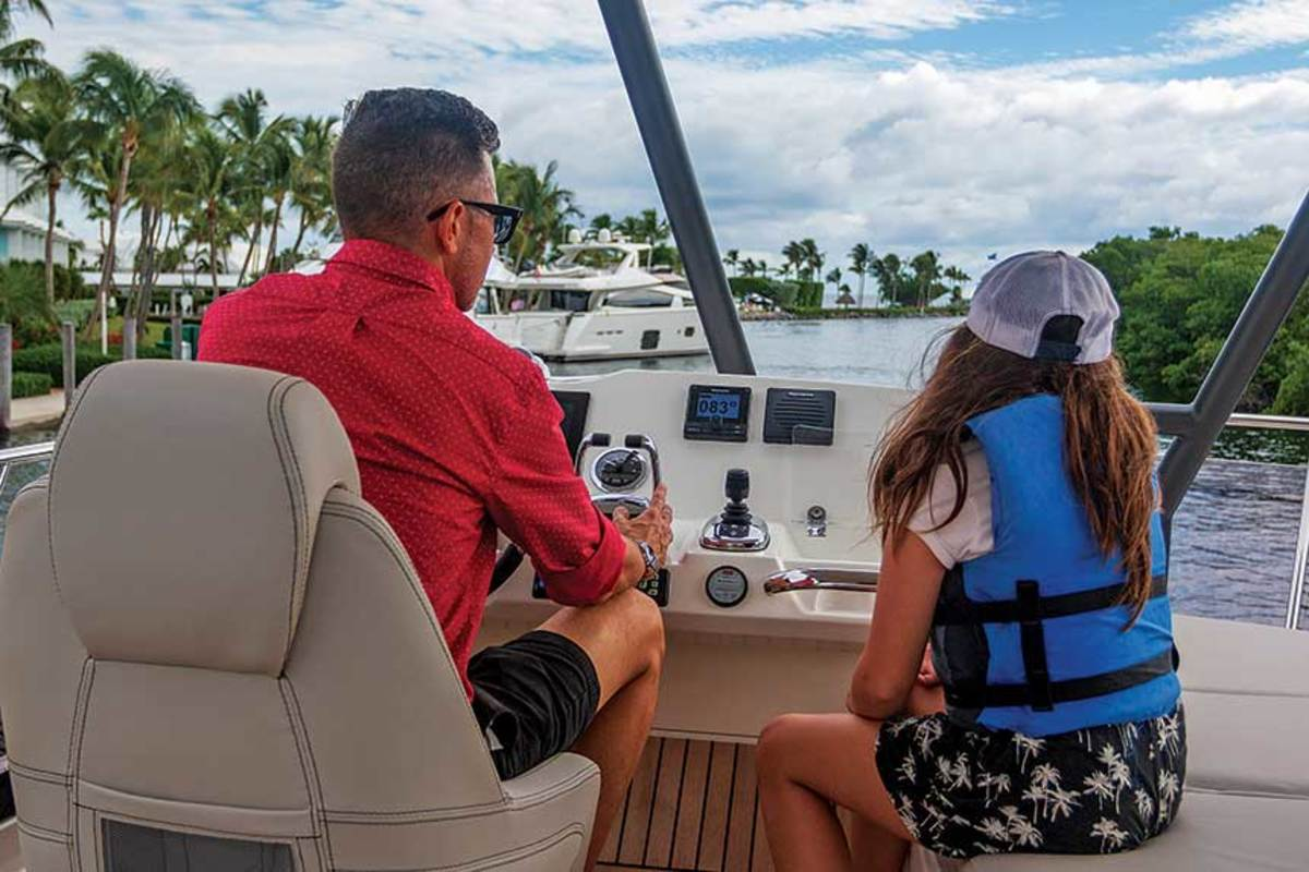 Like many of us, editor-in-chief Moser, here with his daughter, Frankie, longs for family time on the water.