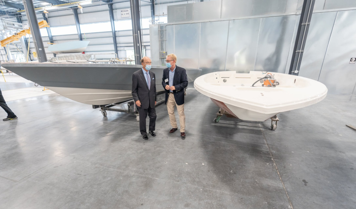 Secretary Ross, left, with Jim Leffew, vice president of manufacturing at Maverick Boat Group.