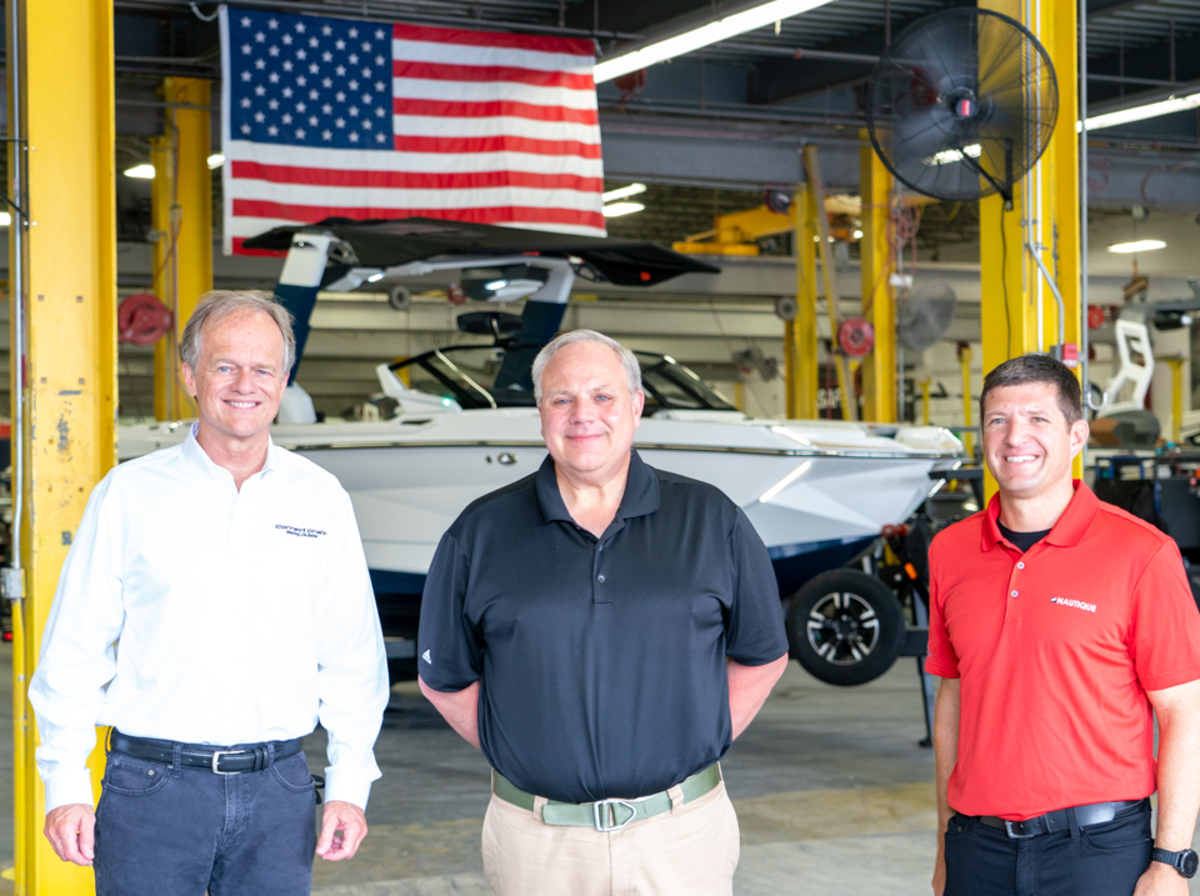 Correct Craft president and CEO Bill Yeargin, Secretary Bernhardt, and Nautique president Greg Meloon.