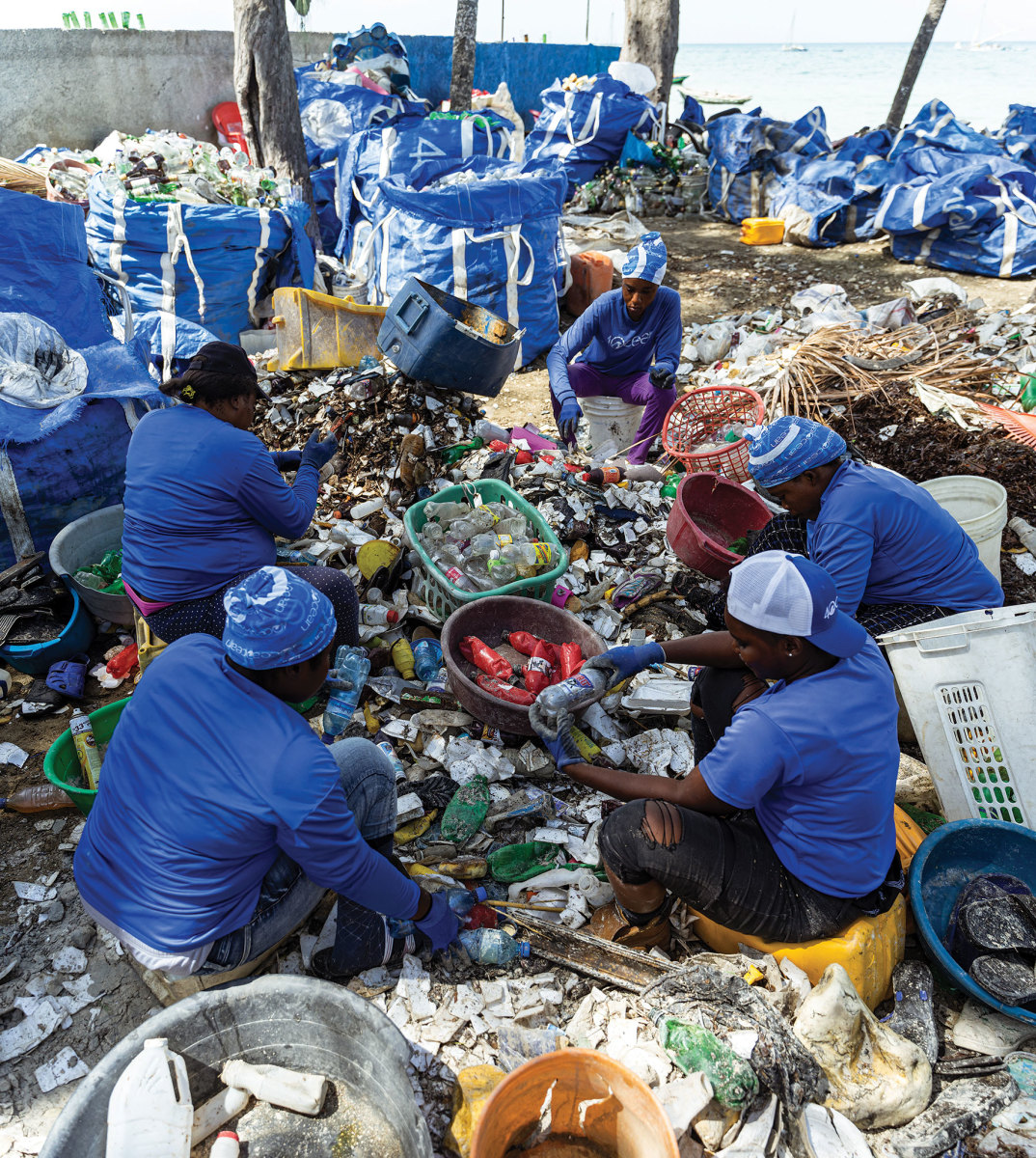 4ocean workers sort plastics recovered from the sea before recycling and upcycling