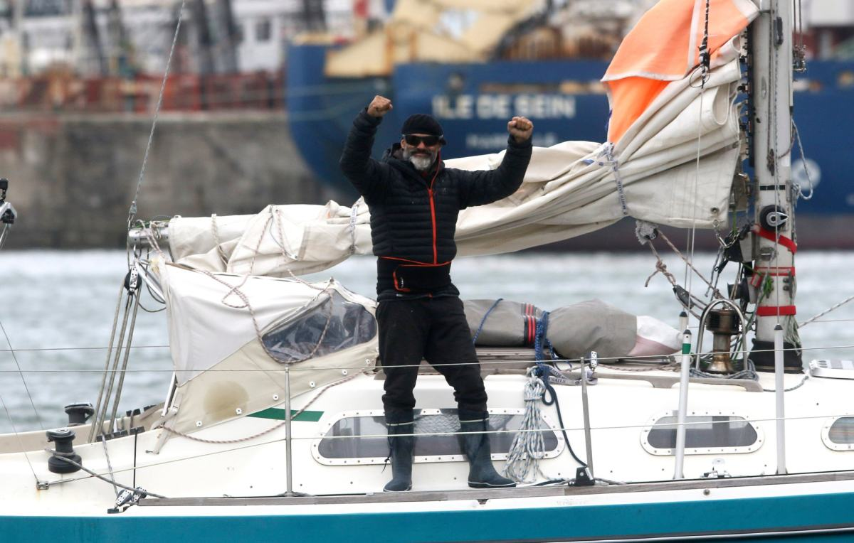 Sailor Juan Manuel Ballestero arrives in Argentina on his 29-foot sailboat after a solo transatlantic voyage. CREDIT: Vicente Robles/Associated Press.