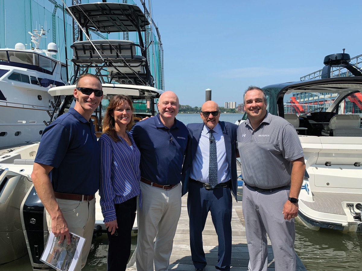 (From left)  Brunswick executives Lee Gordon, Brenna Priesser,  Foulkes and Ryan Gwillim with Mad Money host and CNBC personality Jim Cramer at an event at New York City's Chelsea Piers.
