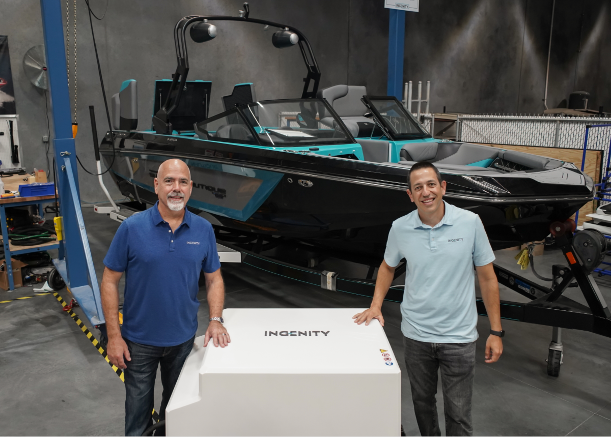 Todd Sims (left) with Watershed Innovation president Sean Marrero and the all-electric Super Air Nautique GS22E.