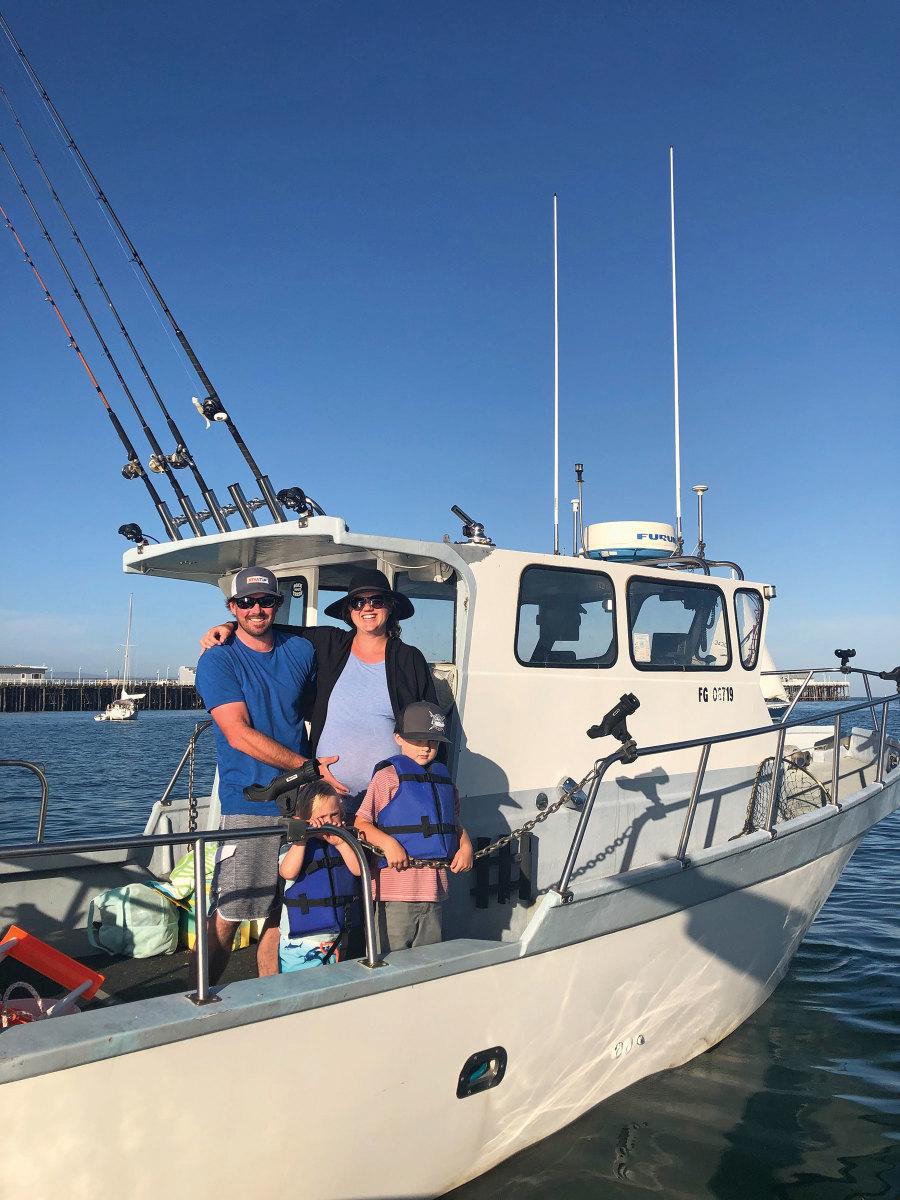 Santa Cruz, Calif., harbormaster Blake Anderson with his family on the harbor-patrol boat.